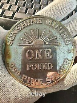 One Pound 1990 Sunshine Mining. 999 Silver Round